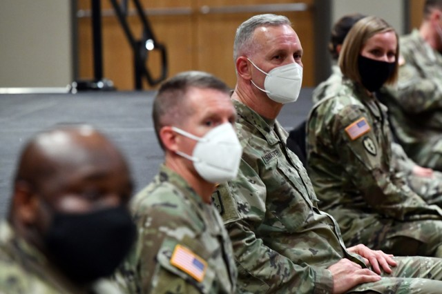 Maj. Gen. Dennis LeMaster (center) and others members of the panel listen as Soldiers asks a question on the Army Combat Fitness Test.
