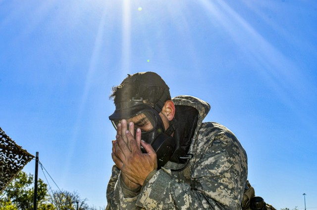 A Soldier clears and seals his gas mask while participating in the Expert Infantryman Badge/Expert Soldier Badge Qualification Course, November 25, 2020, at Fort Hood, TX. The EIB/ESB Qualification is being held by 2nd Armored Brigade Combat Team, 1st Cavalry Division, Fort Hood, TX, until Dec 11. (Army photo by SGT. Broderick Hennington)