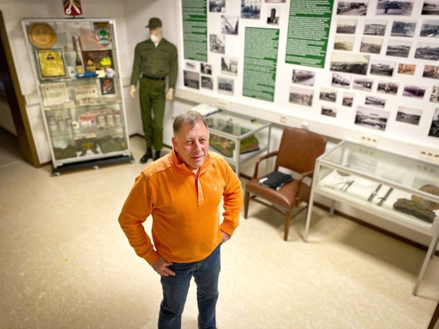 Bernd Mai, USAG Rheinland-Pfalz in Baumholder public affairs specialist, stands in the Baumholder History Room he created in the garrison headquarters building on Baumholder.