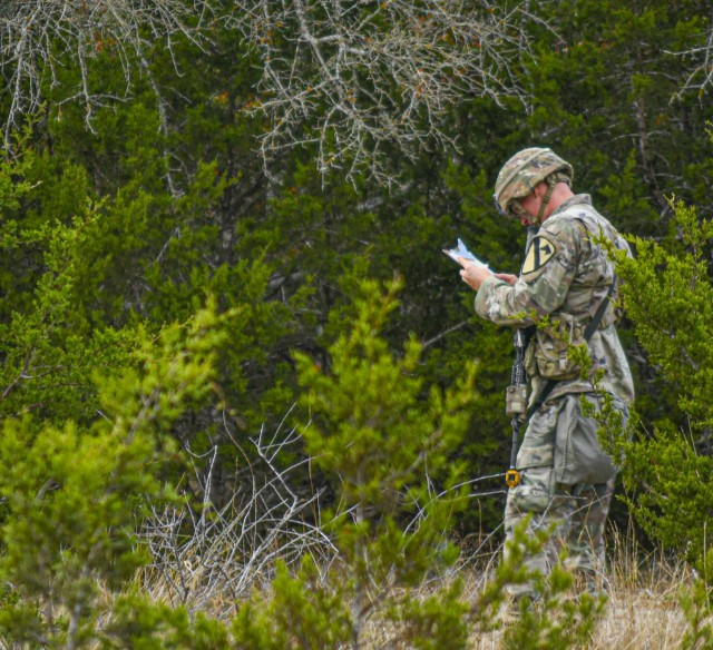 A Soldier with 2nd Armored Brigade Combat Team, 1st Cavalry Division, checks his map on a land navigation lane, while participating in the Expert Infantryman Badge/Expert Soldier Badge Qualification Course, November 25, 2020, at Fort Hood, TX. The EIB/ESB Qualification is being held by 2nd Armored Brigade Combat Team, 1st Cavalry Division, Fort Hood, TX, until Dec 11. (Army photo by SGT. Broderick Hennington)