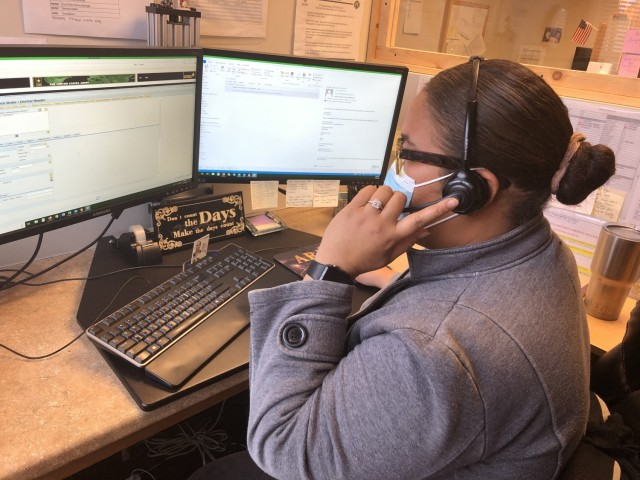 Leilani Cross, service orders clerk, Directorate of Public Works, fields a work order over the phone Dec. 4. The new Army Maintenance Application, or ArMA, currently being fielded at Fort Campbell, is expected to improve the work order process for barracks.