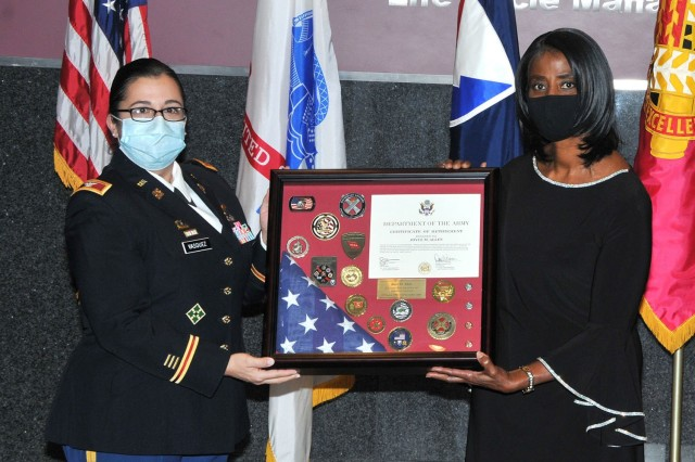 Col. Santee Vasquez (Left), Chief of Staff Tank-automotive and Armaments Command, presents Joyce Allen (Right), Secretary of the General Staff TACOM, with a Meritorious Civilian Service Medal at her retirement ceremony Dec. 9 at the Detroit Arsenal, Michigan.