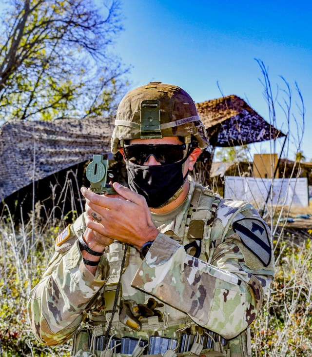 Army SSG Christopher Lanning, with 1st Battalion, 8th Cavalry Regiment, 2nd Brigade Armored Combat Team, 1st Cavalry Division, shoots an azimuth while participating in the Expert Infantryman Badge/Expert Soldier Badge Qualification Course, November 25, 2020, at Fort Hood, TX. The EIB/ESB Qualification is being held by 2nd Armored Brigade Combat Team, 1st Cavalry Division, Fort Hood, TX, until Dec 11. (Army photo by SGT. Broderick Hennington)