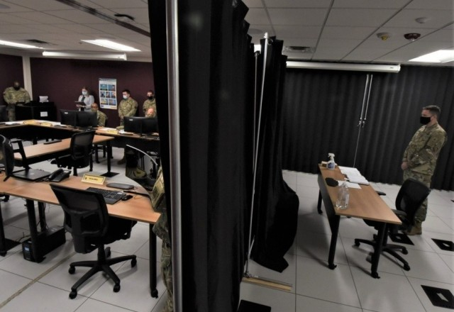An Army officer simulates what candidates will go through when they sit down at the end of the process to participate in a double-blind panel interview with senior Army officers Aug. 11, 2020.