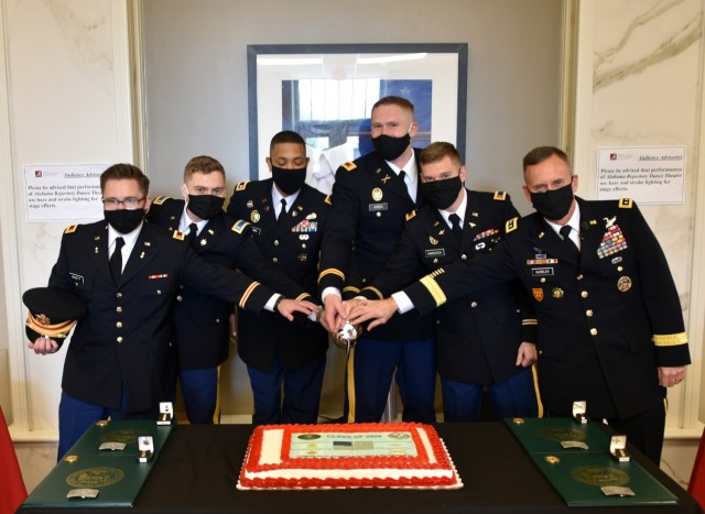Lt. Gen. Daniel L. Karbler, right, commanding general, U.S. Army Space and Missile Defense Command, participates in a ceremonial cake cutting with four graduating University of Alabama ROTC cadets following their commissioning into the Army during the Crimson Tide Battalion Fall 2020 Commissioning Ceremony, Dec. 11. From left are: 2nd Lt. Tucker A. Arnett; 2nd Lt. Matthew T. Fagg; Lt. Col. Antwan D. Brown, professor of military science; 2nd Lt. Noah T. Kren; 2nd Lt. Terry L. Hancock; and Karbler. (U.S. Army photo by Jason B. Cutshaw)