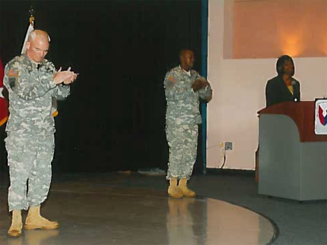 Joyce Allen (Right), Secretary of the General Staff Tank-automotive and Armaments Command, narrates a quarterly awards ceremony in 2009 and provides opening remarks as Maj. Gen. Scott West (Left), then Commanding General TACOM, and Command Sgt. Maj. Otis Cuffee (Center), then Command Sgt. Maj. TACOM, looks on.