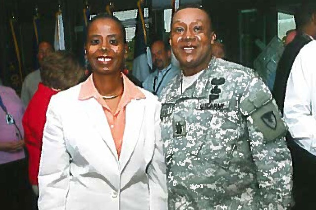Joyce Allen (Left), Secretary of the General Staff Tank-automotive and Armaments Command, poses for a photo with Command Sgt. Maj. Otis Cuffee, former Command Sgt. Maj. for TACOM, following an awards ceremony in 2006