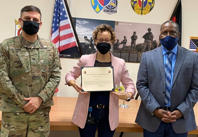 The 405th Army Field Support Brigade commander, Col. Brad Bane, presents the Logistics Readiness Center Rheinland-Pfalz Employee of the Year for 2020 award to Marsha Kaiser, a property book officer and acting LRC Rheinland-Pfalz administrative specialist.