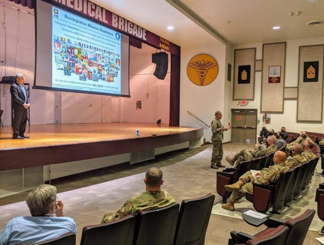 Maj. Gen. Daniel R. Walrath, right, commanding general, U.S. Army South, provides remarks during the Reintegration Working Group mission readiness brief at Evans Auditorium Dec. 3. U.S. Army South hosted the annual Personnel Recovery Reintegration Working Group as part of the command's role to facilitate the personnel recovery reintegration process. Army South is U.S. Southern Command's designated command to conduct phase one and phase two reintegration for all Soldiers, Sailors, Airmen, Marines and DoD civilians and contractors in the SOUTHCOM area of responsibility. Additionally, Army South conducts Army service-level phase three reintegration for all Soldiers and DA civilians and contractors worldwide. Army South also has a memorandum of understanding with the other services to support service phase three reintegration at JBSA.