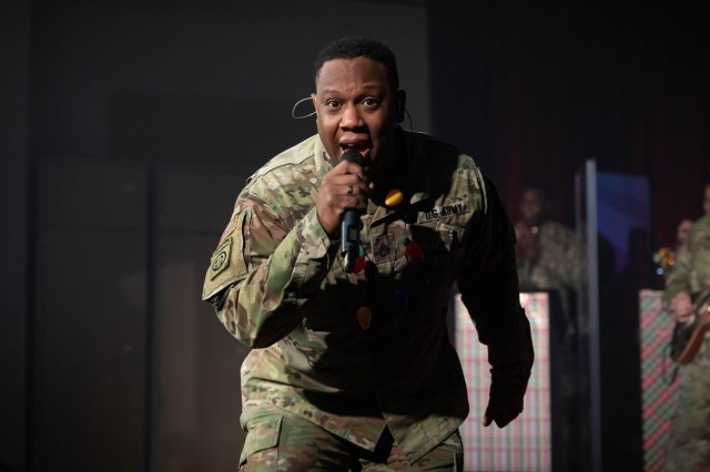Staff Sgt. Lewis Johnson, lead vocalist for the U.S. Army Training and Doctrine Command Band holiday show, rocks out on their virtual stage. (U.S. Army photo by Staff Sgt. Osvaldo Corea)