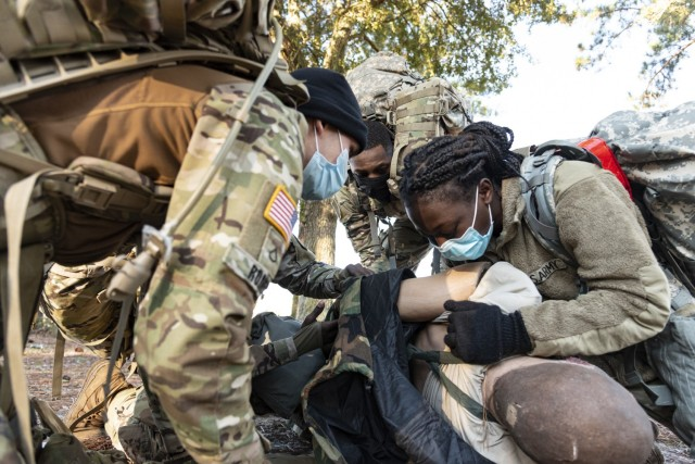 Soldiers from Headquarters and Headquarters Company, 83rd Chemical, Biological, Radiological, and Nuclear Battalion on Fort Stewart Georgia, perform Tactical Combat Casualty Care on a mock casualty, Dec. 10, 2020. The team had to assess the casualty's injuries, call a nine line medical evacuation request and move the casualty to safety. The TCCC lane was part of HHC's Ghost Rider Challenge that provided leadership opportunities to aspiring leaders that normally only officers and noncommissioned officers get. (U.S. Army photo by Spc. Robert P Wormley III)