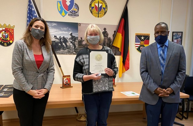 The 405th Army Field Support Brigade deputy commanding officer, Jody Fasko, presents a certificate of recognition to Sabine Gundacker for 30 years of service in the government of the United States of America. Gundacker was recognized at the Logistics Readiness Center Rheinland-Pfalz' annual awards ceremony Dec. 15 at the headquarters on Daenner Kaserne.