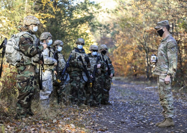 U.S. Army Command Sgt. Maj. Robert Abernathy (right), command sergeant major, U.S. Army Europe and Africa, discusses Operation Courageous Ascent, a training exercise designed to test medical operations in austere environments, with Soldiers participating in the exercise, Nov. 18. The exercise tested medical personnel on a variety of combat medical skills such as applying combat action tourniquets, casualty evacuation, dismounted patrolling, land navigation, movement under fire, communications protocol, identifying and reacting to improvised explosive devices and chemical, biological, radioactive and nuclear attacks.
