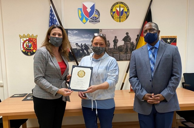 The 405th Army Field Support Brigade deputy commanding officer, Jody Fasko, presents a certificate of recognition to Irina Conkel for 40 years of service in the government of the United States of America. Conkel was recognized at the Logistics Readiness Center Rheinland-Pfalz' annual awards ceremony Dec. 15 at the headquarters on Daenner Kaserne.
