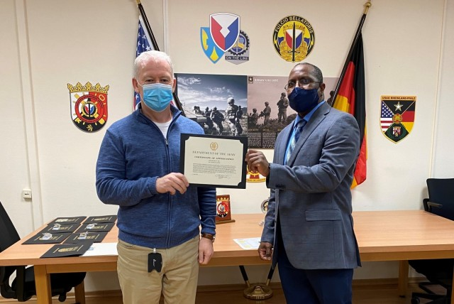 The Logistics Readiness Center Rheinland-Pfalz director, Gregory Terry, presents a certificate of appreciation to Gerry Clohessy during the LRC Rheinland-Pfalz' annual awards ceremony Dec. 15 at the headquarters on Daenner Kaserne.