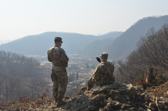 Soldiers from the 2nd Armored Brigade Combat Team, 1st Infantry Division improve their readiness and ability to fight by surveying the terrain and drawing sector sketches at Camp Casey, Republic of Korea. The brigade provided an armor capability on the peninsula to deter regional threats and strengthen peace in northeast Asia.(U.S. Army photo by Kpfc. Chung, In Ha)