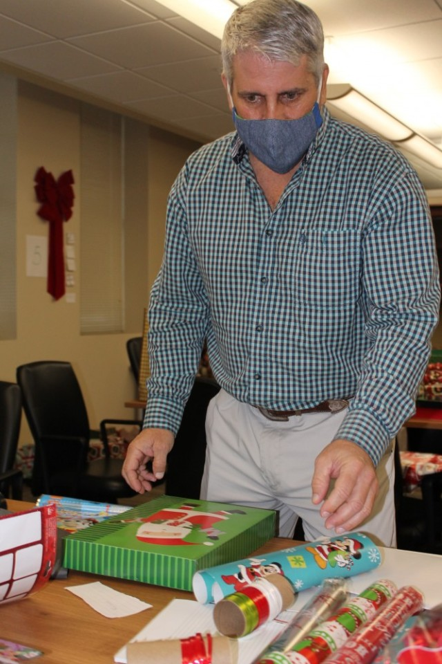 Matt Mattox, a range scientist, boxes up wishes for delivery to families participating in the Angel Tree gift program.