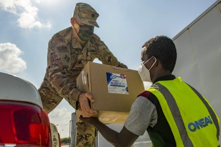 A U.S. Soldier helps distribute personal protective equipment for the National Office of Water and Sanitation in Djibouti, Dec. 2, 2020. The equipment included masks, gloves, hand sanitizer and alcohol solution.