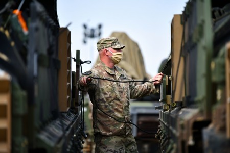 A Soldier assigned to Bravo Company, 2nd Battalion, 12th Cavalry Regiment conducts vehicle preparation procedures during Phase II of Exercise Defender-Europe 20 at the Drawsko Pomorskie Training Area in Poland, July 20, 2020. The deployment exercise is designed to build strategic readiness in support of the U.S. National Defense Strategy and NATO deterrence objectives. In response to the COVID-19 pandemic, it was modified in size and scope. Phase I was linked to Exercise Allied Spirit, which took place June 5-19 with about 6,000 U.S. and Polish soldiers. In Phase II of the modified exercise, a U.S. based combined arms battalion is conducting an emergency deployment readiness exercise to Europe that is scheduled to end Aug. 22, 2020.