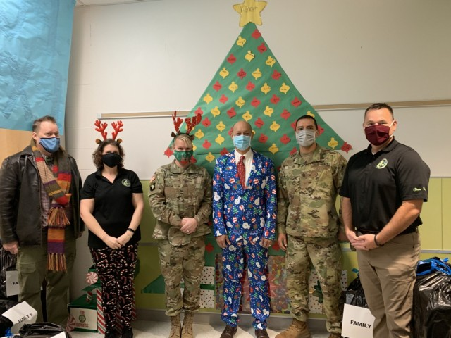 The USAEC team delivers bags of presents to the Fort Sam Houston Elementary School as part of their Adopt-A-School program Angel Tree.