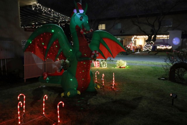 An inflatable dragon wearing a Santa hat lights up a yard at Camp Zama, Japan, Dec. 13.