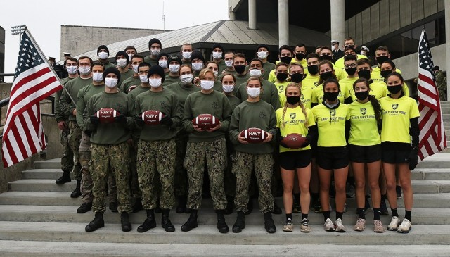 Members of the Army West Point Marathon team and the U.S. Naval Academy's 13th Company get together on the steps of the Holleder Center after the 5-kilometer esprit de corps run to finish the Army-Navy Ball Run prior to Saturday's Army-Navy Game.
