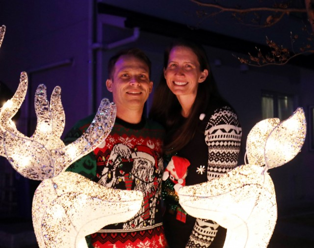 John and Amy Eads, who have an extensive display of holiday decorations at their home, pose for a photo in their front yard at Sagamihara Family Housing Area, Japan, Dec. 13.