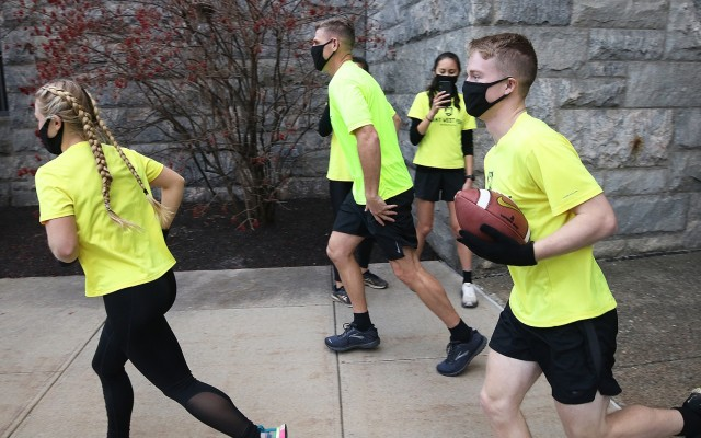 Department of Physical Education Director, Col. Nicholas Gist (center), joins  members of the Army West Point Marathon team during the Army-Navy Ball Run Friday at West Point.