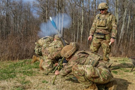 A U.S. Army mortar team leader with 1st Brigade Combat Team, 101st Airborne Division (Air Assault), observes his team fire a M244 Lightweight Mortar during a live-fire exercise at Fort Campbell, Kentucky, Feb. 4, 2020.