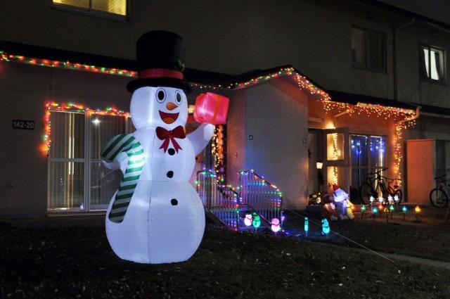 A large snowman lights up a front yard at Sagamihara Family Housing Area, Japan, Dec. 8.