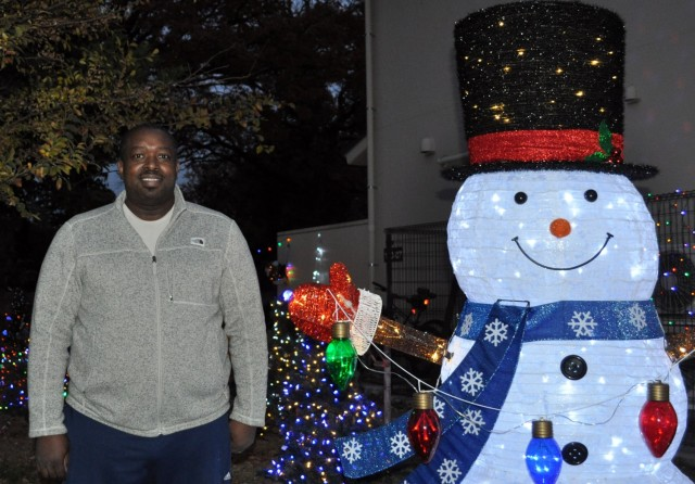 Parish Jones, who decorates his yard extensively for the holidays, poses for a photo at his home at Sagamihara Family Housing Area, Japan, Dec. 13.