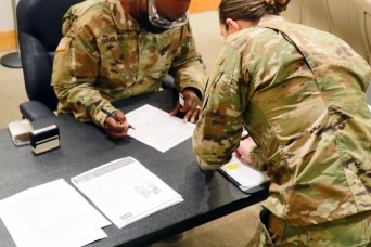 Army ICU nurse receives first COVID-19 vaccine at BAMC