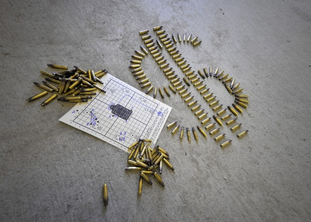 Combat arms instructors at the 354th Security Forces Squadron us an engagement skills trainer to save money prior to Airmen firing live ammunition.  An engagement skills trainer is a computer based training module which uses air compression and a surround sound system coupled with specially designed weapons to produce a shooting experience almost as good as the real thing (U.S. Air Force photo by Senior Airman Shawn Nickel/Released)
