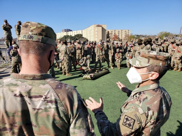 (Right) Lt. Col. Manuel Menendez, 232d Medical Battalion Commander, briefs (left) Gen. Paul Funk II, U.S. Army Training and Doctrine Commander on the Battalion's Best Advanced Individual Training (AIT) Medic Competition at Joint Base San Antonio-Fort Sam Houston, Texas on December 17, 2020. Photo by Capt. Maddison Wild, MEDCoE.