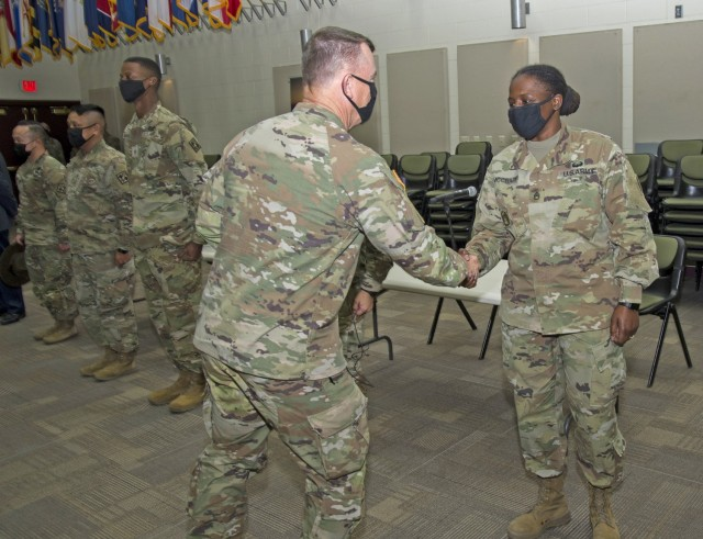 During his second visit to the U.S. Army Medical Center of Excellence this year, Gen. Paul Funk II, U.S. Army Training and Doctrine Commander received a 70B Health Services Administration Track Brief and conducted leader professional development sessions with Basic Officer Leaders Course students and MEDCoE battalion and company commanders.  Funk also participated in a physical training and sensing session with Advanced Individual Training (AIT) Soldiers.  At each event, Funk took the time to recognize Soldier and leaders for excellence with a commander's coin. Photo courtesy Joint Base San Antonio Multimedia.