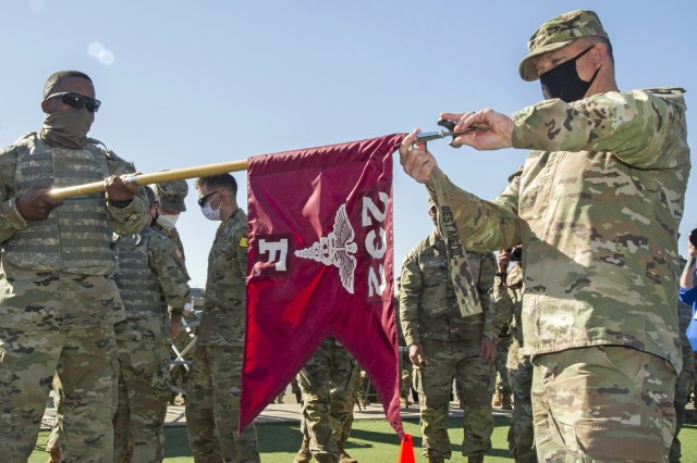 Gen. Paul Funk II, U.S. Army Training and Doctrine Commander presents the Best Advanced Individual Training (AIT) Medic Competition streamer to the winning unit, Foxtrot Company, 232d Medical Battalion at Joint Base San Antonio-Fort Sam Houston, Texas on December 17, 2020. Photo courtesy Joint Base San Antonio Multimedia.