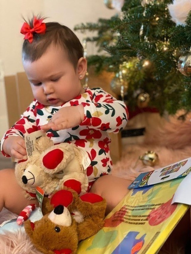 Mariana Marin Marrero, 10 months, plays with toys that were collected during Operation Homefront's annual holiday toy drive. Mariana is the daughter of Staff Sgt. Lorraine M. Marrero Olson, a Soldier assigned to a U.S. Army Recruiting Command station in Naples, Fla.