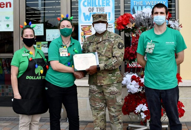 Capt. Garnett Lias presents a certificate of appreciation to staff members of a Dollar Tree store that collected toys for Soldiers in its community. Lias is the commander of Sarasota Company, Tampa Recruiting Battalion, 2nd Recruiting Brigade.