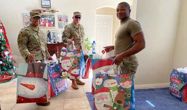 Soldiers from Tampa Recruiting Battalion in Florida pickup toys for distribution to families assigned to the battalion's Sarasota Company. Nearly 20,000 toys were donated at Dollar Tree stores throughout the battalion's communities for the children of enlisted Soldiers. The toys were distributed to Soldiers assigned to each of the battalion's five companies.