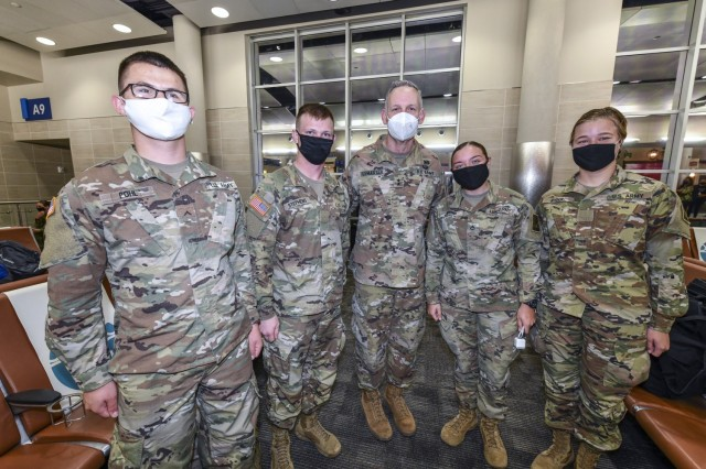 Maj. Gen. Dennis LeMaster, U.S. Army Medical Center of Excellence Commanding General pictured with Soldiers departing training MEDCoE for Holiday Block Leave on December 19, 2020. (Pictured from left to right:  Pvt. Colton Pohl, Pvt. Logan Stephens, Maj. Gen. Dennis LeMaster, Pvt. Elena Butler and Pvt. Abby Ryder.)