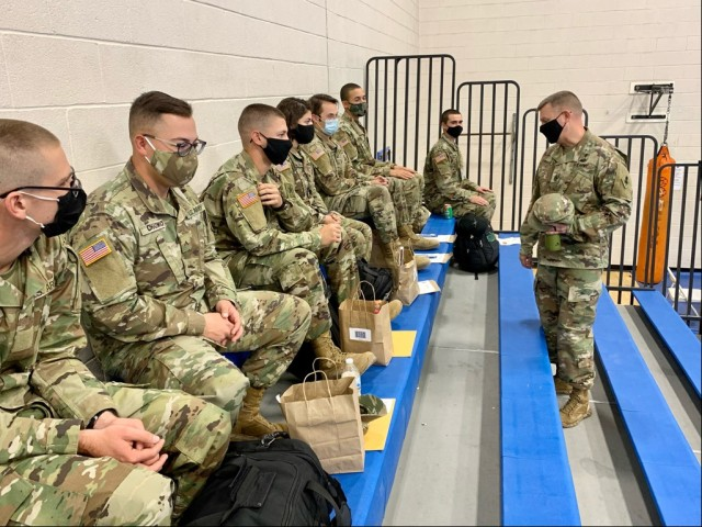 """U.S. Army Intelligence Center of Excellence Command Sgt. Maj. Warren  """"Kelly"""" Robinson asks Soldiers where they are traveling for the holidays and advises them to do physical training while at home in order to be ready and resilient to resume training in January."""