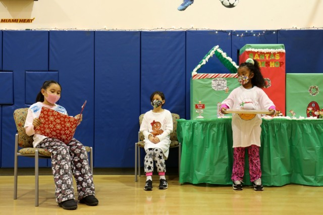 From left, Leila Kaea, 9, Andrea Crispell, 9, and Mia Stewart, 7, perform in the holiday play at the School Age Center at Sagamihara Family Housing Area, Japan, Dec. 18.