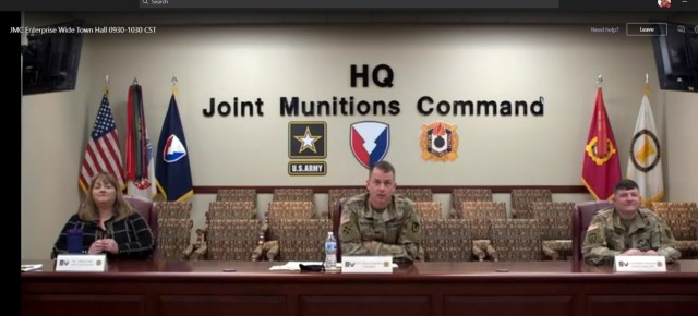 Col. Gavin J. Gardner, center, Commander of Joint Munitions Command, addresses the JMC workforce virtually, December 16, 2020, during his first town hall.  Joining him were JoEtta Fisher, Executive Director of Ammunition and Deputy to the Commander, left, and Command Sgt. Maj., Brian Morrison, right.