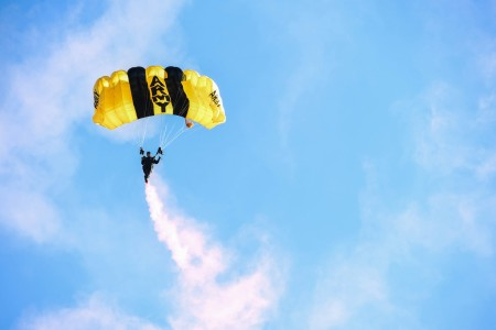 A member of The United States Army Parachute Team, the Golden Knights, descends to the ground on Fort Belvoir, Va., Nov. 10, 2020. This jump was one of several events conducted at the National Museum of the United States Army, prior to its opening.
