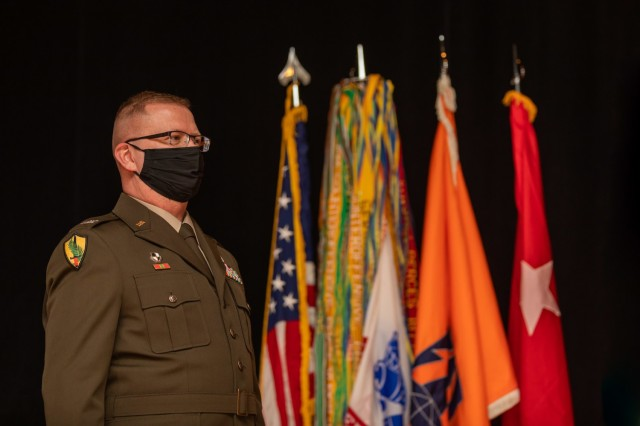 U.S. Army Reserve Col. Robert Powell Jr stands during his promotion ceremony at Fort Gordon, Georgia, Dec. 15, 2020. With the promotion, Powell will serve as the deputy commanding general 335th Signal Command (Theater) (U.S. Army photo by Capt. David Gasperson)