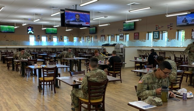 Soldiers enjoy their meal in the updated dining facility at Fort Wainwright. New furniture was brought in, along with the instillation of 30 televisions and the addition of Wi-Fi.