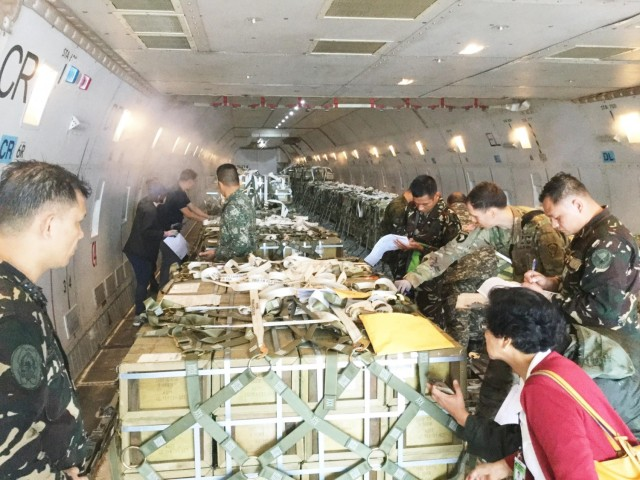 U.S. and Philippines military forces conduct inventory of ammunition delivery.  Note: this picture was taken prior to COVID protective measures (social distance, masks) were put into place.