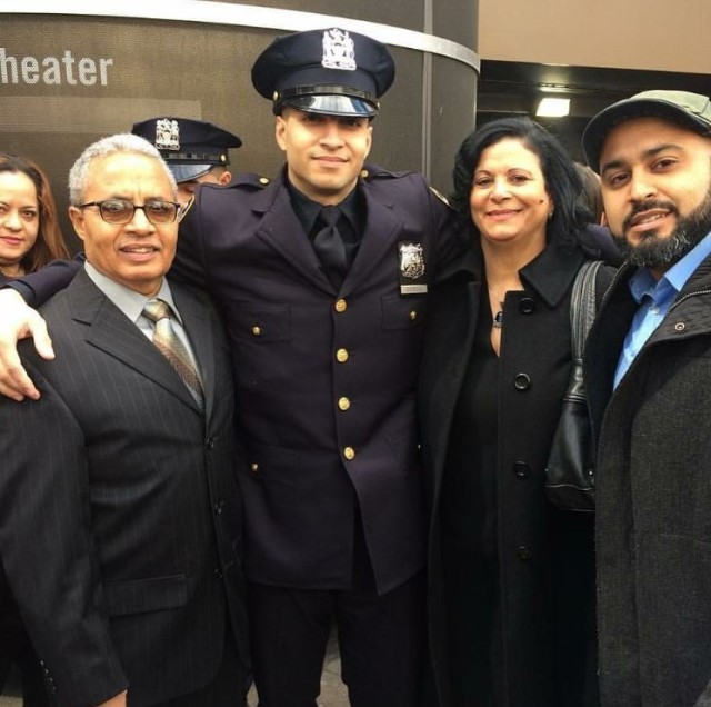 Staff Sgt. Samuel Garcia, intelligence analyst noncommissioned officer, 719th Movement Control Battalion, poses for a photo with his father and mother Adalberto and Maria Garcia, along with his brother Ronny Garcia at his New York City Police Academy graduation. (Courtesy Photo)