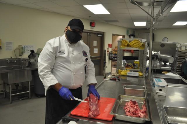 Martin Army Community Hospital Head Chef Francisco Elias prepares a filet.