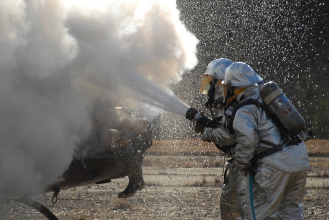 Firefighters use extinguish a helicopter fire during a training exercise in 2007. Photo credit: U.S. Army Photo